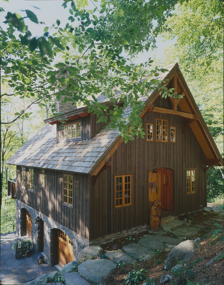 Small rustic brown three-story wood gable roof idea in Boston