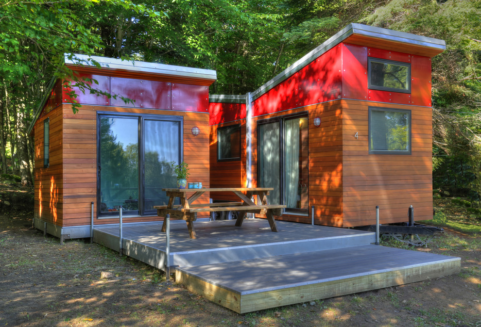 Example of a small minimalist red one-story mixed siding exterior home design in New York with a shed roof