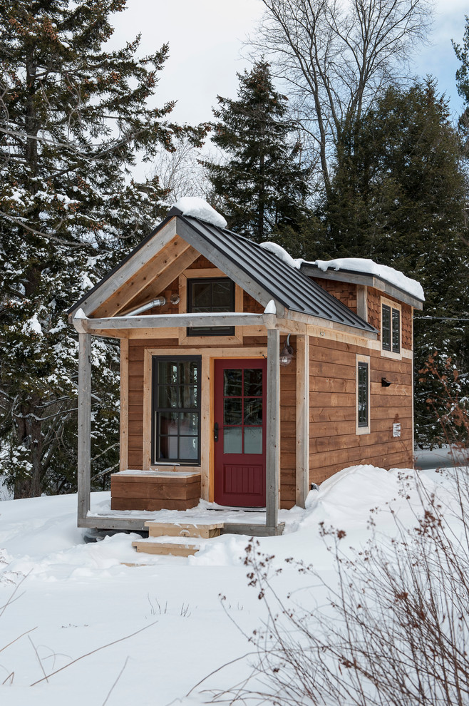 Example of a small mountain style two-story wood gable roof design in Burlington