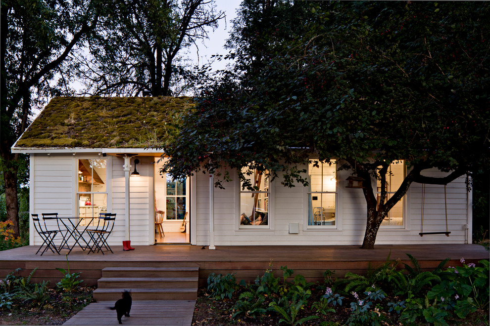 Inspiration for a small cottage white one-story wood exterior home remodel in Portland with a green roof