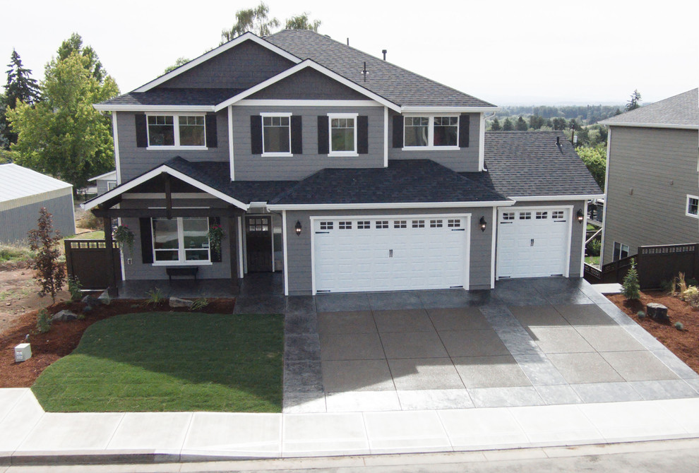 Inspiration for a mid-sized timeless gray two-story wood gable roof remodel in Portland