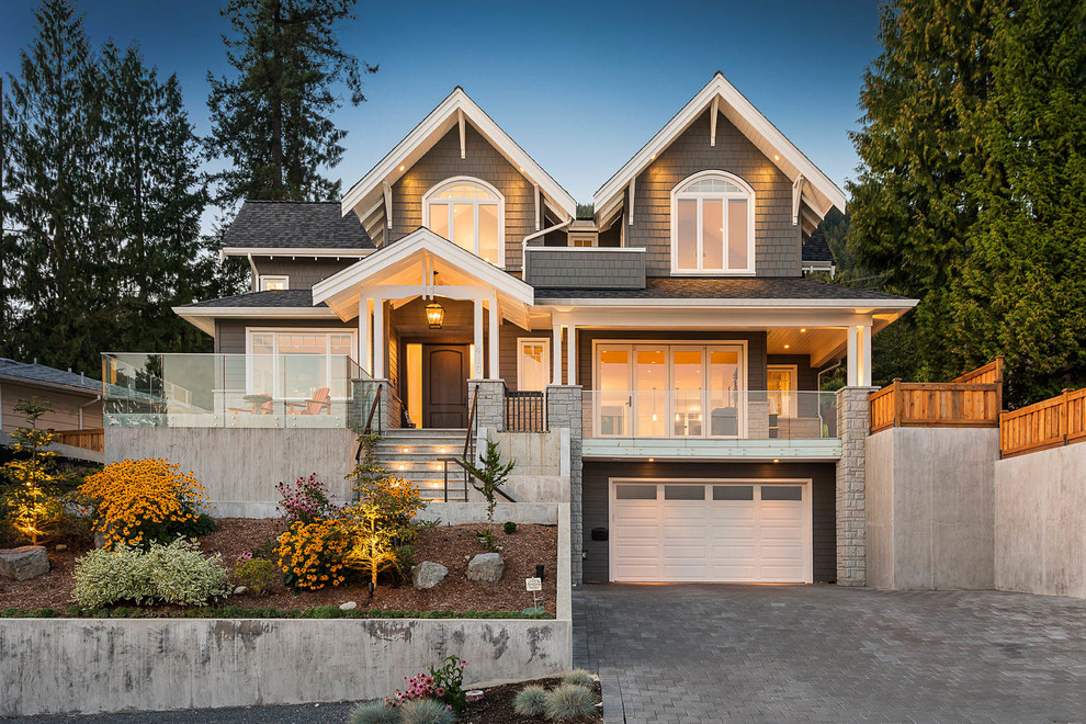 Inspiration for a large timeless gray two-story wood house exterior remodel in Vancouver with a hip roof and a shingle roof