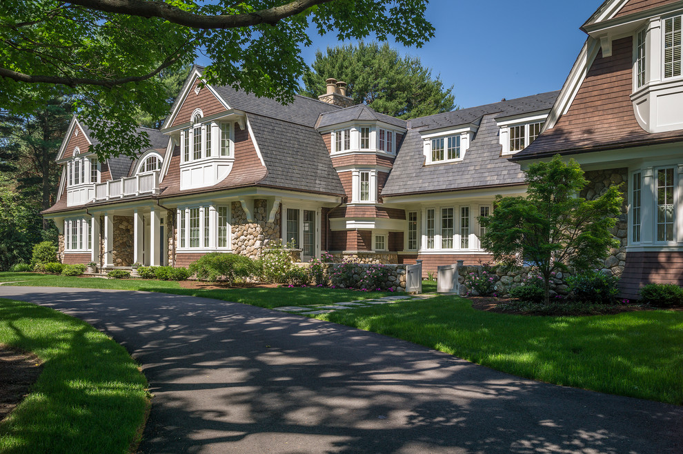 Ornate two-story wood exterior home photo in Boston