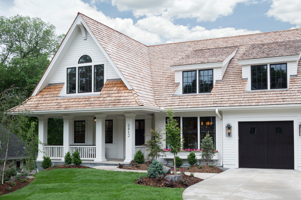 Inspiration for a timeless white two-story exterior home remodel in Minneapolis with a shingle roof