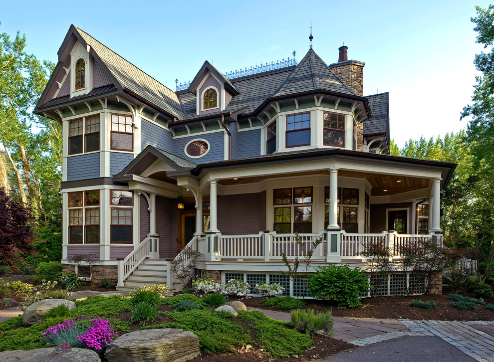 Large victorian purple two-story wood exterior home idea in New York