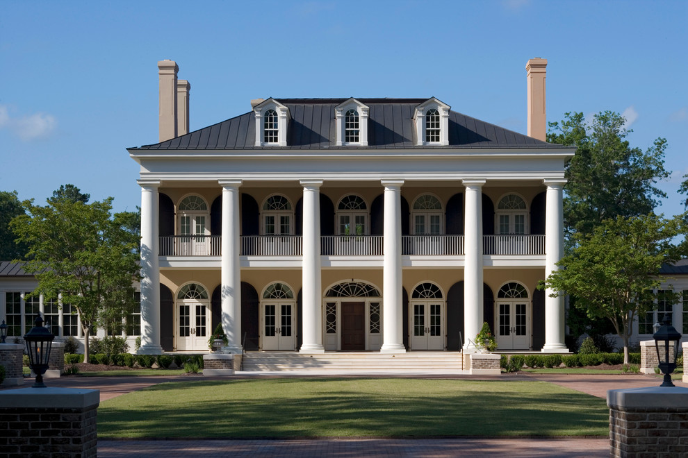 Example of a classic three-story exterior home design in Charleston