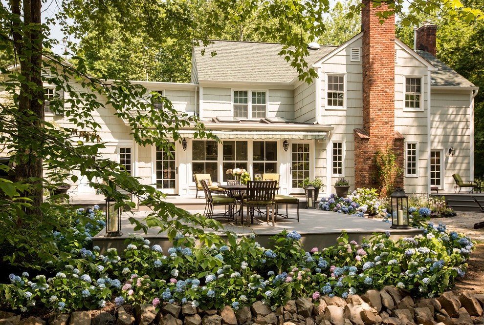 Inspiration for a timeless white two-story exterior home remodel in New York