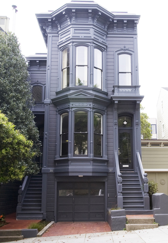 Mid-sized victorian purple two-story wood exterior home idea in San Francisco