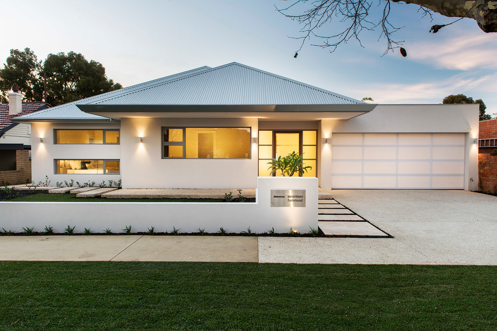 Large transitional white one-story exterior home photo in Perth with a hip roof