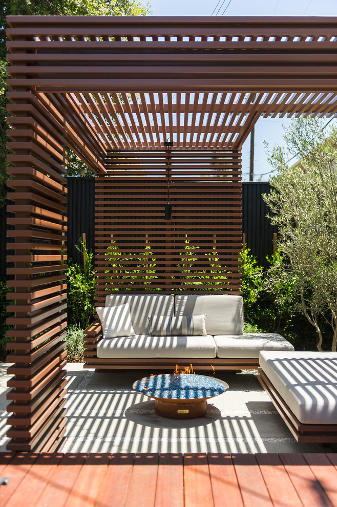 Inspiration for a small contemporary white one-story mixed siding flat roof remodel in Los Angeles