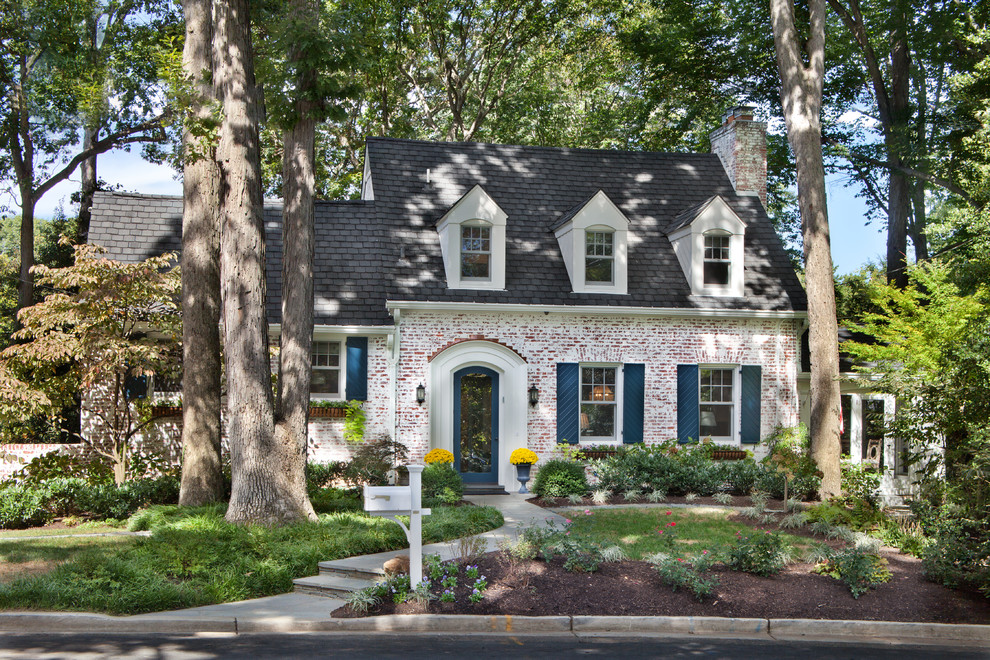 Elegant brick exterior home photo in DC Metro