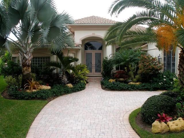 Tropical design with boulders tropical exterior for Exterior landscape design