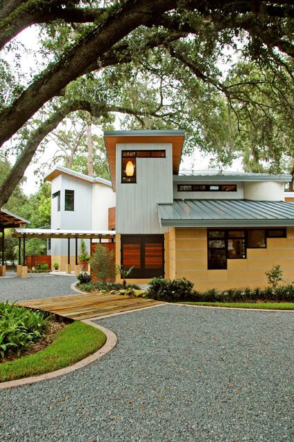 Tropical home contemporary exterior orlando by for Modern tropical house exterior