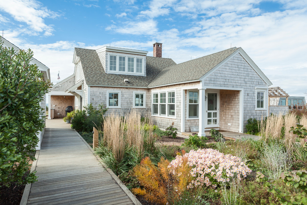 Inspiration for a coastal two-story wood gable roof remodel in Boston