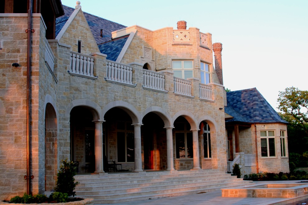 Large elegant beige two-story stone house exterior photo in Dallas