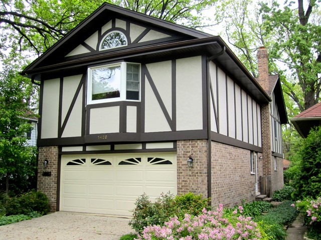Wilmette il tudor style home in james hardie stucco style for Tudor siding