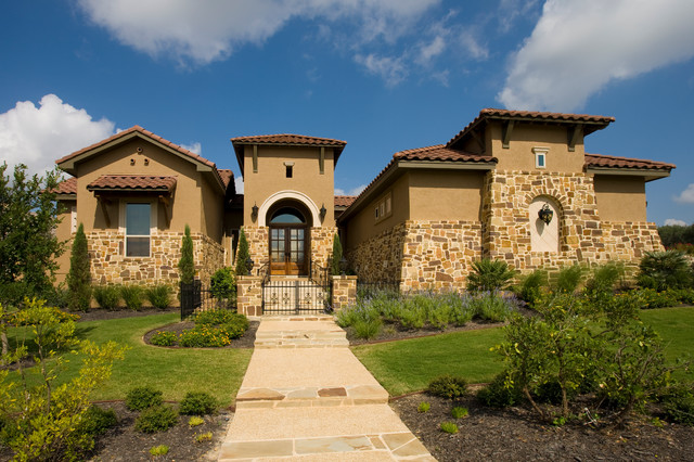Tuscan style home by jim boles custom homes for Tuscany style homes