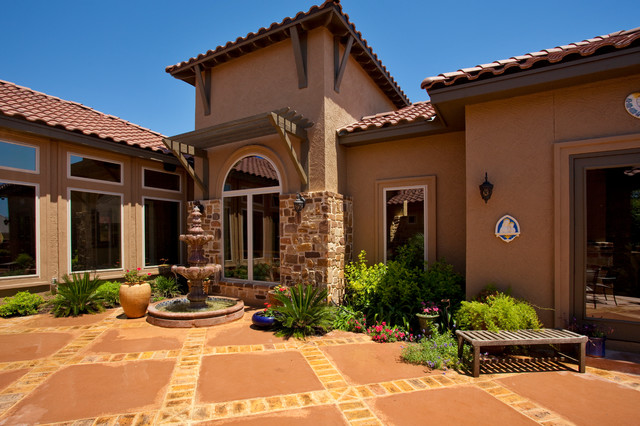 Tuscan style home by jim boles custom homes for Mediterranean style exterior