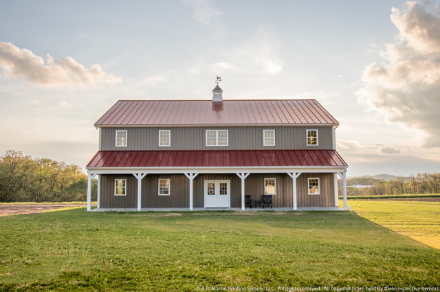 Two story pole barn with colonial red abseam roof and for Two story metal building homes