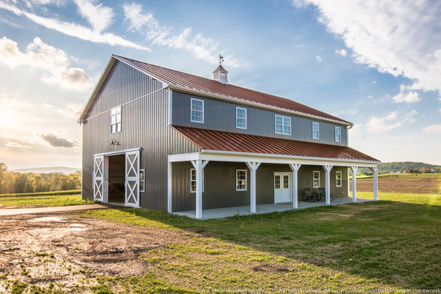 Two story pole barn with colonial red abseam roof and for 2 story barn house