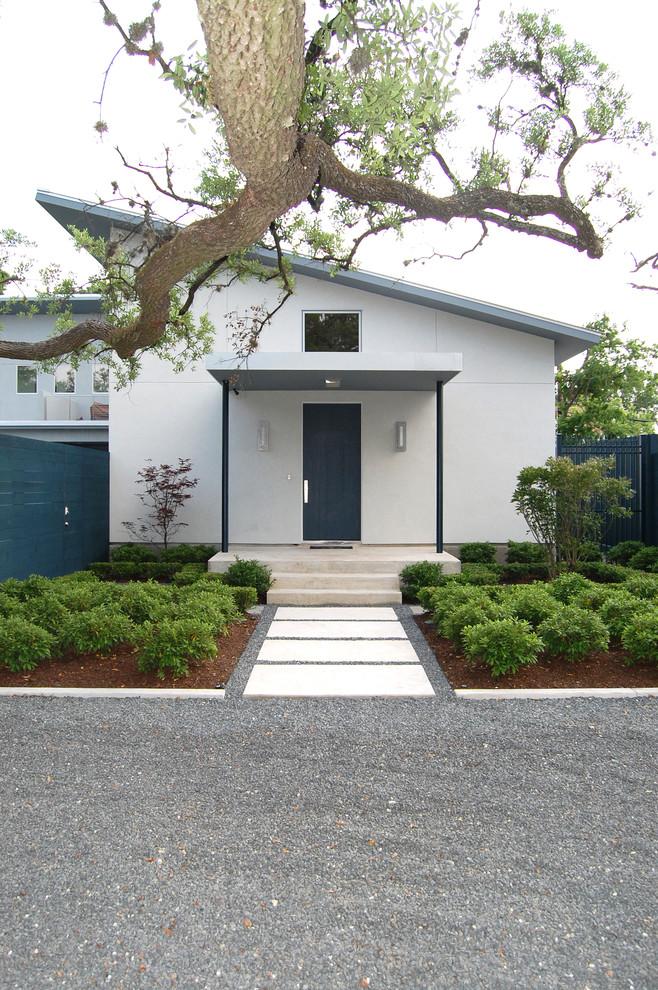 Contemporary white exterior home idea in Houston