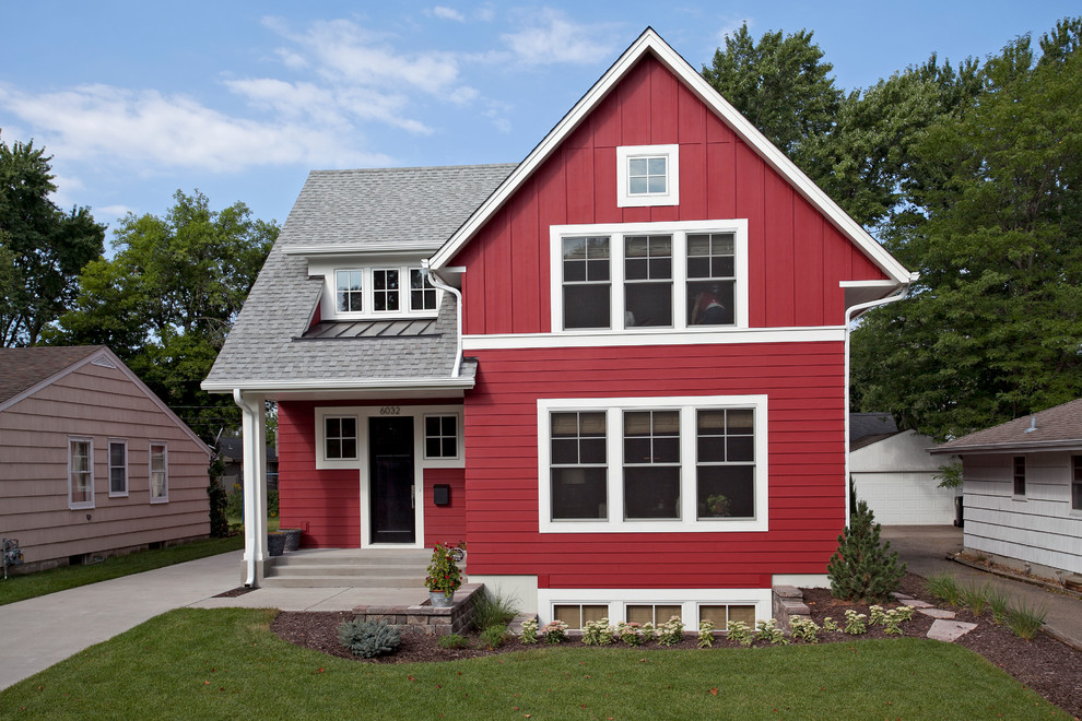 Inspiration for a small country red two-story wood gable roof remodel in Minneapolis