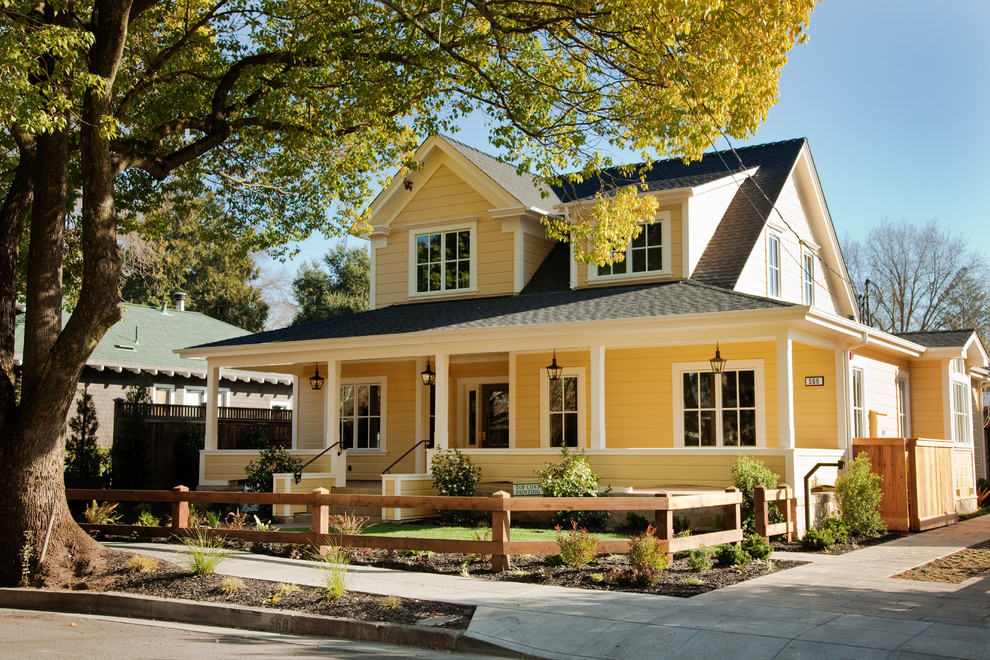 Mid-sized farmhouse yellow two-story gable roof idea in San Francisco