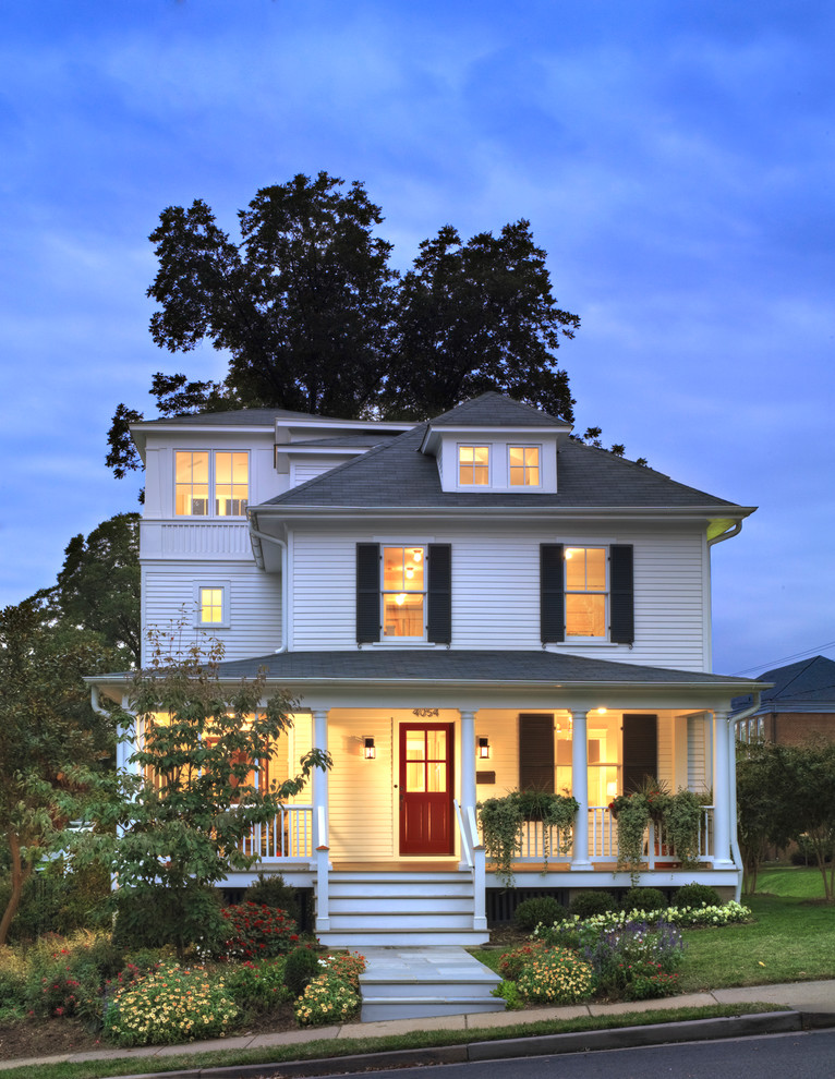 Mid-sized farmhouse white three-story wood exterior home photo in DC Metro with a hip roof