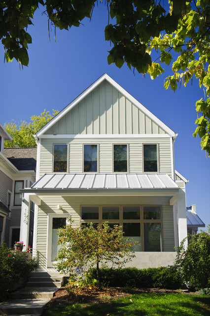 Urban two story home with contemporary details metal roof