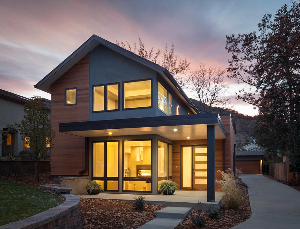 Inspiration for a modern wood exterior home remodel in Denver