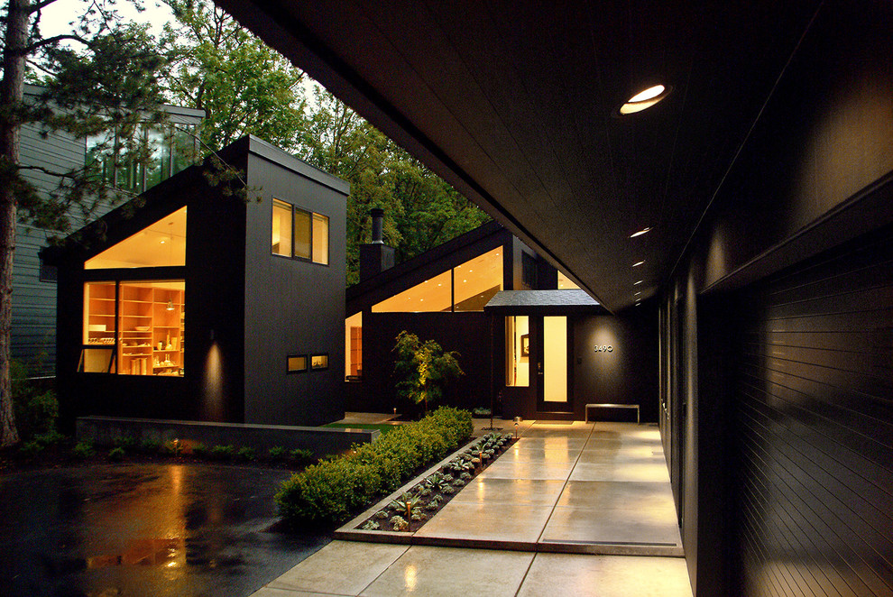 Trendy black exterior home photo in Portland