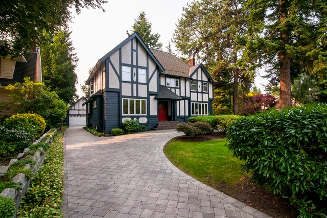 Inspiration for a timeless red stucco exterior home remodel in Vancouver