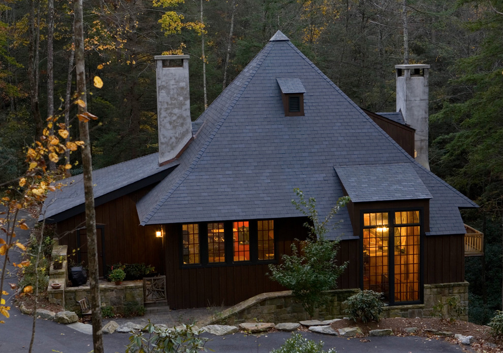 Example of an ornate one-story exterior home design in Birmingham with a hip roof and a shingle roof