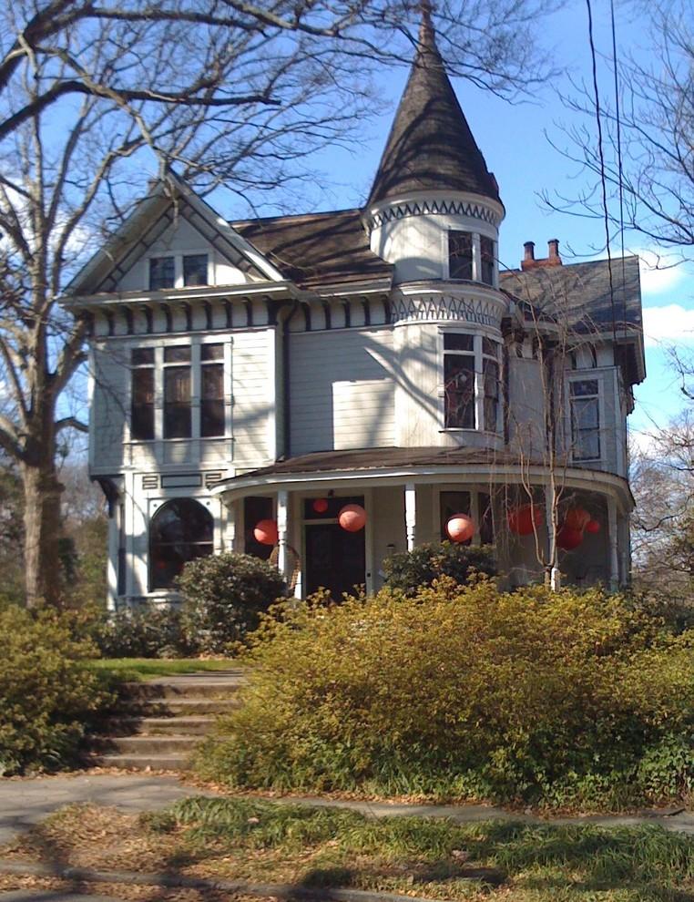 Ornate wood exterior home photo in Atlanta