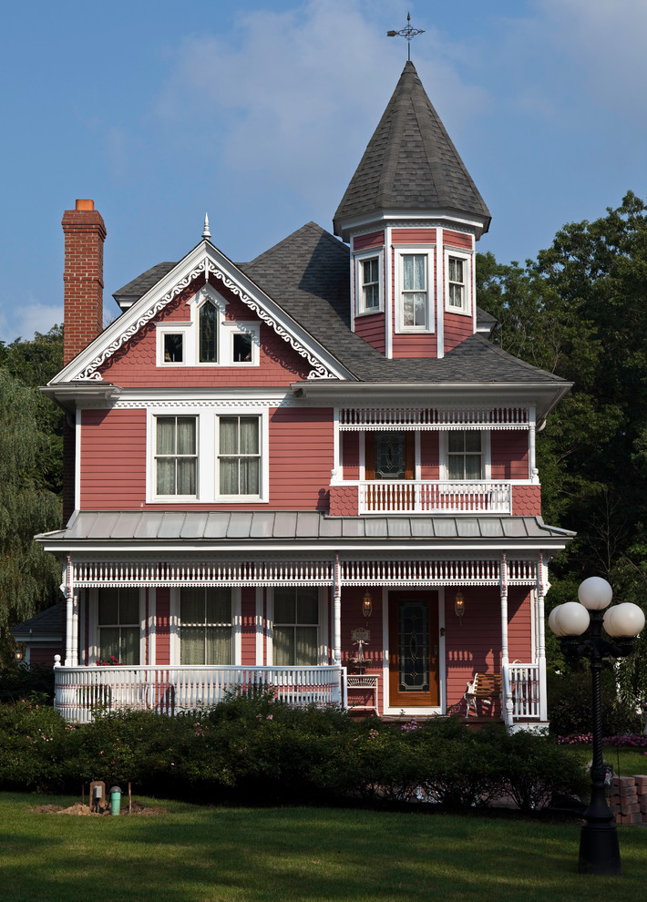 Inspiration for a mid-sized victorian red two-story wood gable roof remodel in Philadelphia