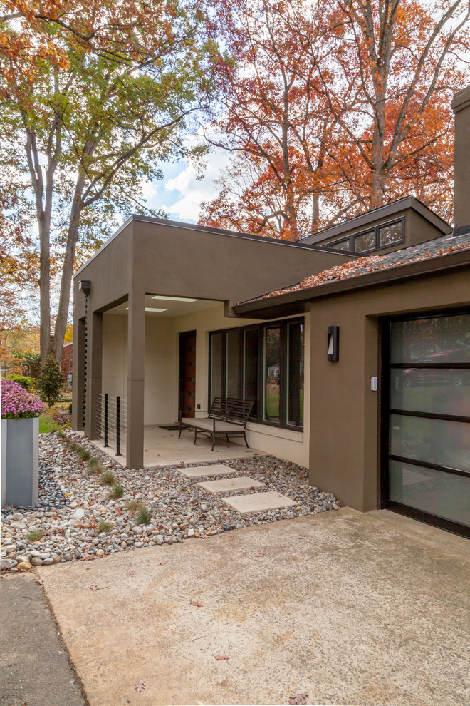 Example of a trendy brown one-story exterior home design in DC Metro