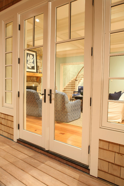 View into great room at dusk traditional exterior - Traditional french doors exterior ...