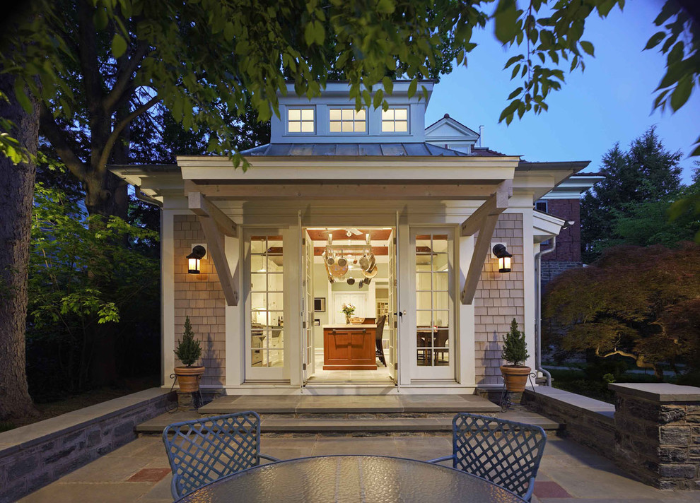 Example of a transitional wood exterior home design in Philadelphia