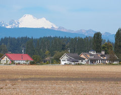View of farmstead looking north with Mount Baker in the background. farmhouse-exterior