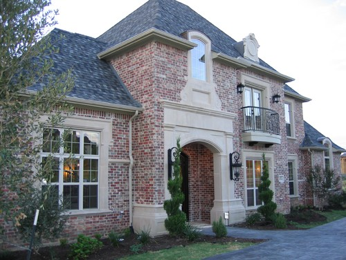 What Is The Color Of The Brick And Trim Colors Around Windows?
