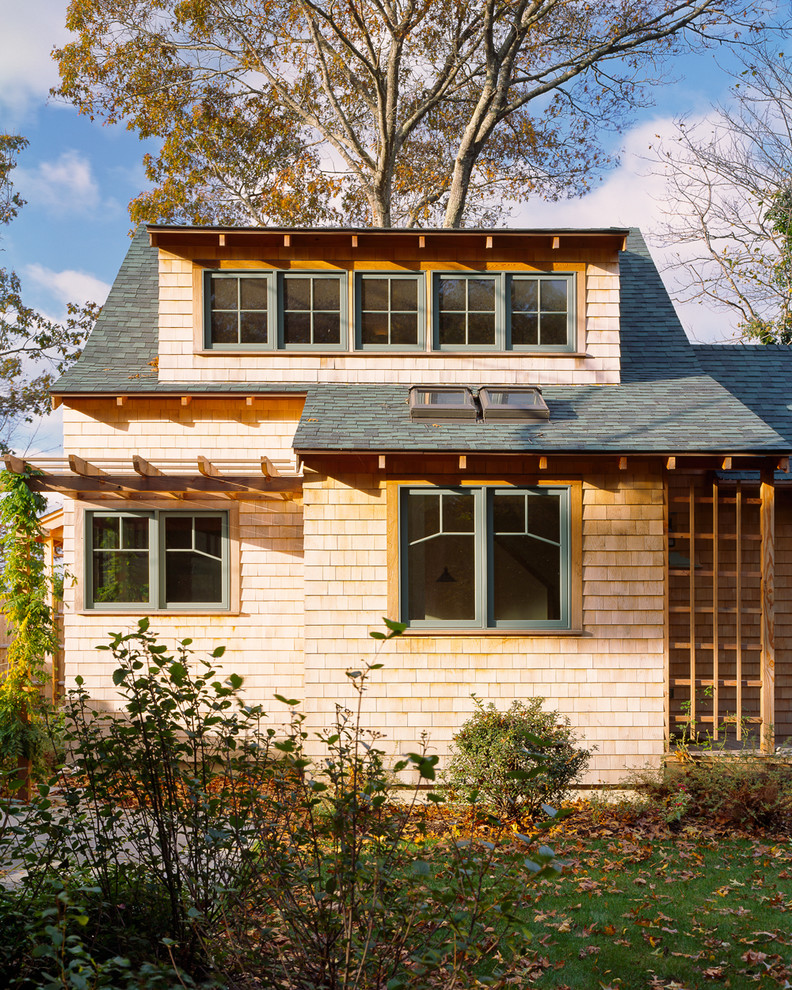 Example of a small classic two-story wood exterior home design in Boston