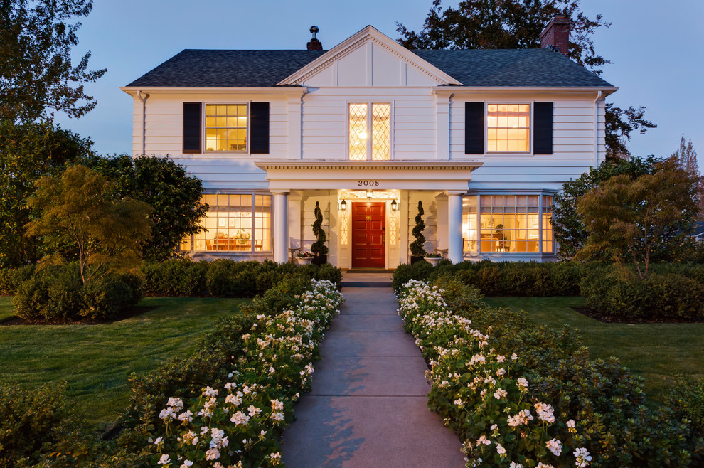 Mid-sized elegant white two-story gable roof photo in Portland