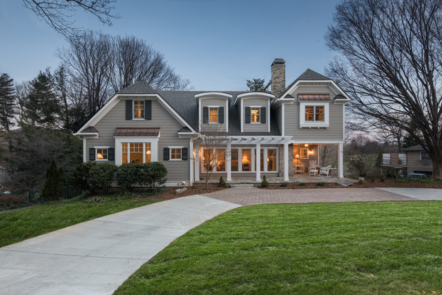 Example of a large arts and crafts gray two-story mixed siding exterior home design in Other with a clipped gable roof