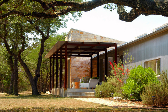 Example Of An Urban Metal Exterior Home Design In Austin