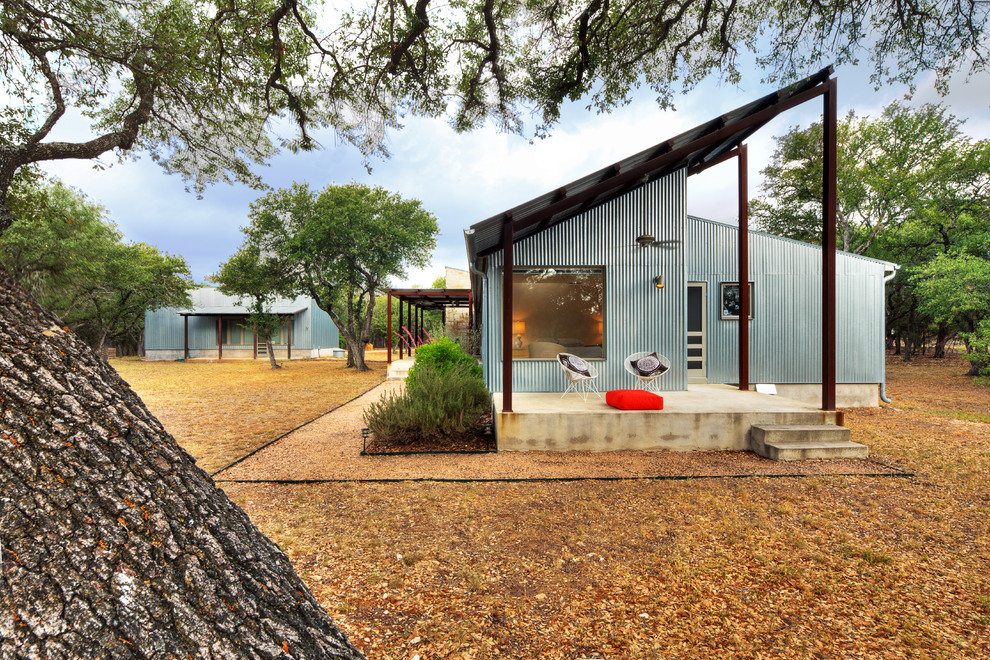 Industrial metal exterior home idea in Austin with a shed roof