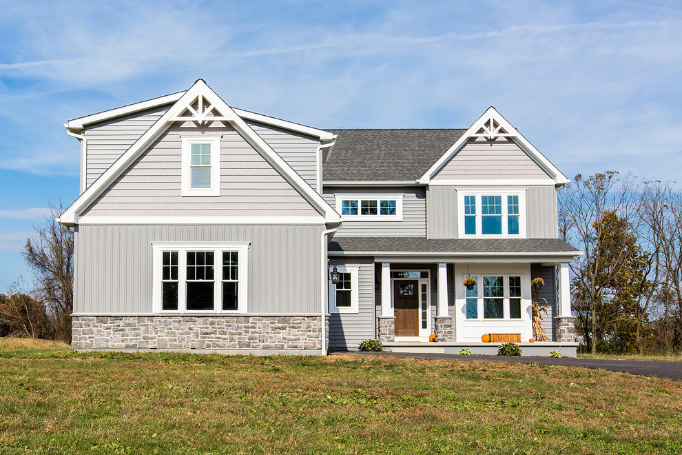 Cottage gray two-story mixed siding exterior home photo in Philadelphia with a shingle roof