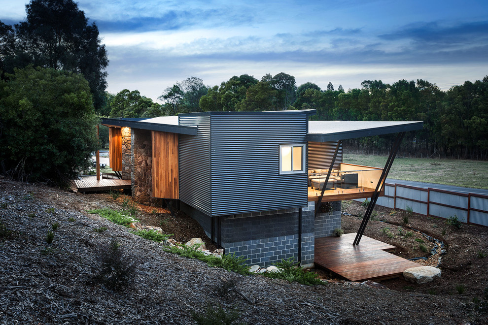 Large contemporary gray split-level mixed siding exterior home idea in Melbourne with a shed roof