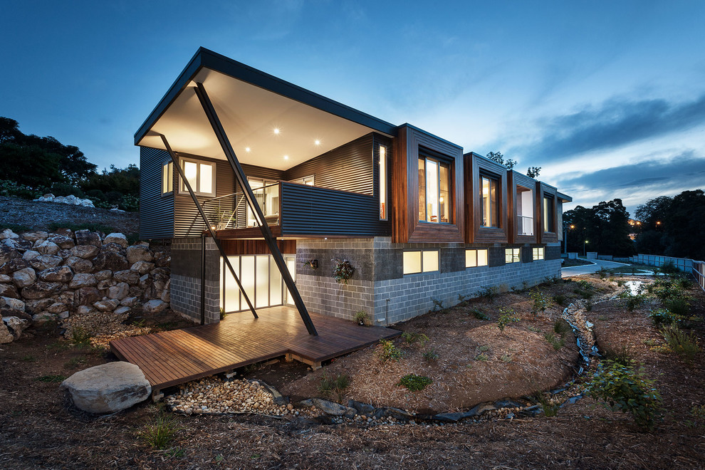 Large trendy split-level mixed siding exterior home photo in Melbourne with a shed roof