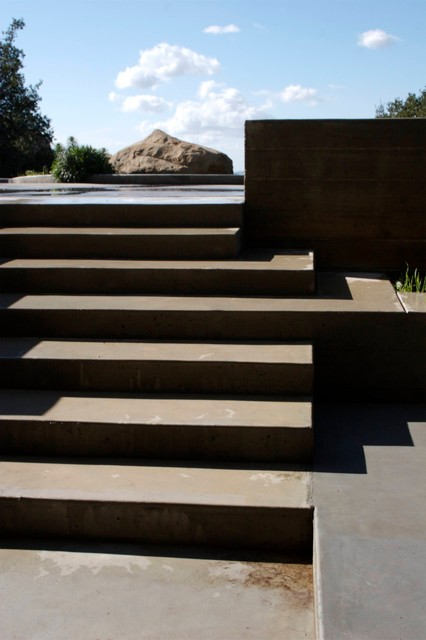 Washed and exposed concrete architectural steps modern for Modern house exterior stairs
