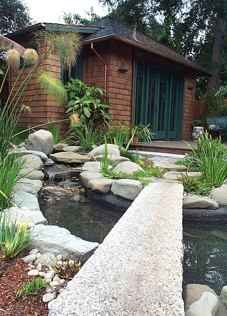 water feature, granite stepping bridge, shingled cottage, copper gutters traditional exterior